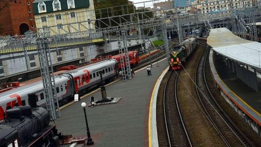 A train makes its way into a railway station in Russia's far eastern city Vladivostok on September 4, 2012. At least 76 people were injured Sunday when a Russian passenger train travelling from Siberia derailed near the Black Sea, the emergency situations ministry said, giving its latest toll.