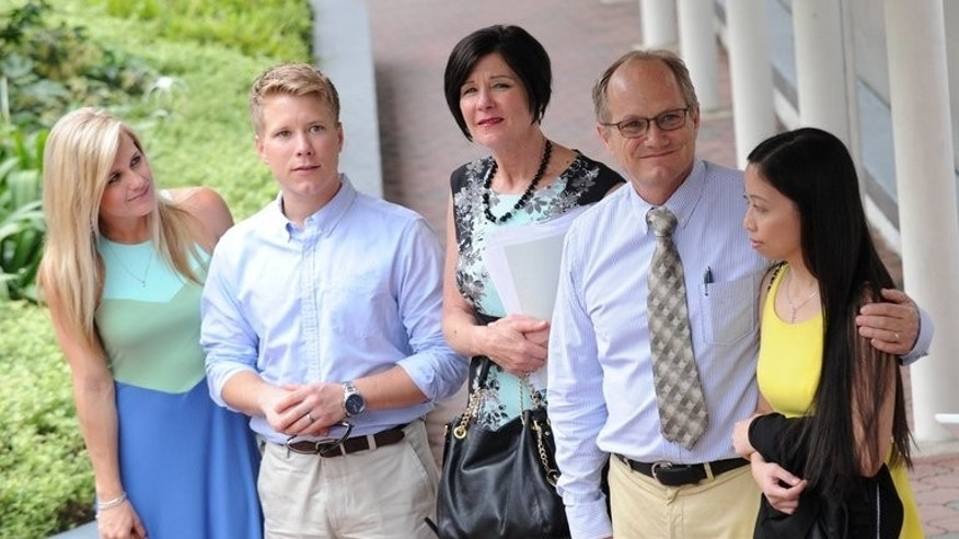 Rick Todd (2nd R), his wife Mary (C), his son Chet (2nd L) and daughter-in-law Corynne (L) and the former girlfriend of the late Shane Todd, Shirley Sarmiento (R), arrive in court in Singapore on May 14, 2013. The state coroner is set to issue the verdict Monday on the controversial death of Shane Todd, who was found hanged in the city-state and whose family believe he was murdered.