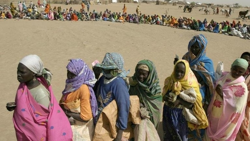"Displaced families receive food aid distributed by World Vision in Kalma Camp, near Nyala in Darfur in 2005. A second World Vision staff member was killed when fighting erupted in Nyala city on Thursday, which officials in South Darfur state blamed on ""differences"" between members of the security forces."