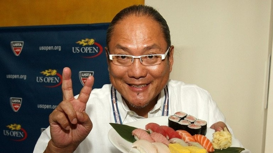 Chef Masaharu Morimoto presents a plate of sushi at the US Open in New York last August. If Andy Murray becomes Britain's first men's Wimbledon champion in 77 years, he'll celebrate with a modest plate of sushi and a piece of chocolate in stark contrast to the growing hysteria of his compatriots.