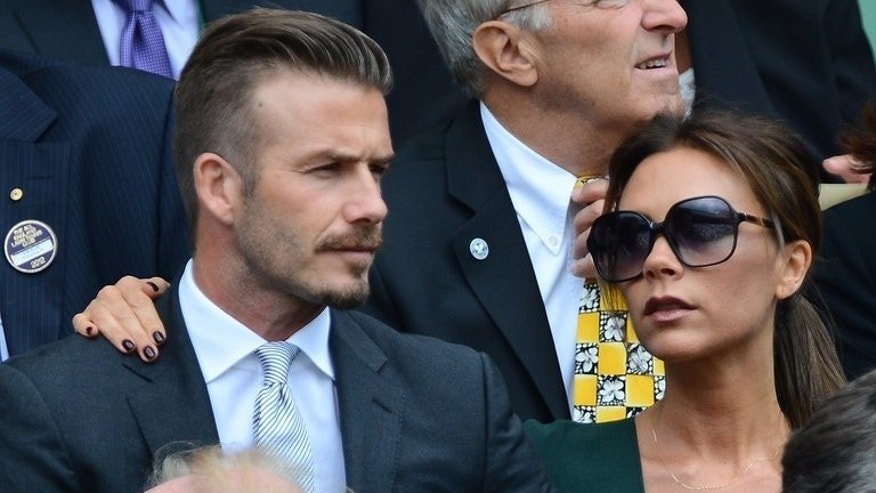 Victoria and David Beckham watch last year's men's singles final at Wimbledon. Victoria Beckham, Wayne Rooney as well as actors Gerard Butler and Bradley Cooper will be taking their seats in Centre Court on Sunday in the hope of seeing history made.