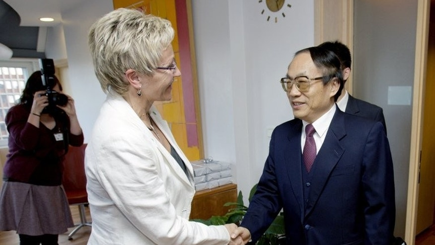 Then minister for Chinese railways, Liu Zhijun (R), meets Norwegian officials in Oslo on May 11, 2009. Liu was given a suspended death sentence on Monday for his role in a huge corruption scandal.