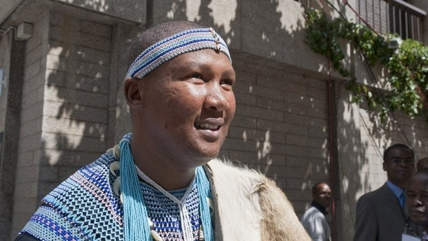 Mandla Mandela arrives at parliament in Cape Town for an event in February 2011. A South African traditional king will try to revoke the chieftaincy of Nelson Mandela's grandson Mandla after a bitter family feud over gravesites, South African media reported Sunday.