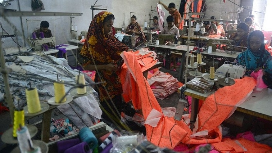 Bangladeshi labourers work in a small garments factory on the outskirts of Dhaka, on May 29, 2013. Seventy top retailers have pledged to improve worker safety and allow inspection of all of their garment factories in Bangladesh within nine months under a pact signed with unions after a deadly factory collapse, a statement said Monday.