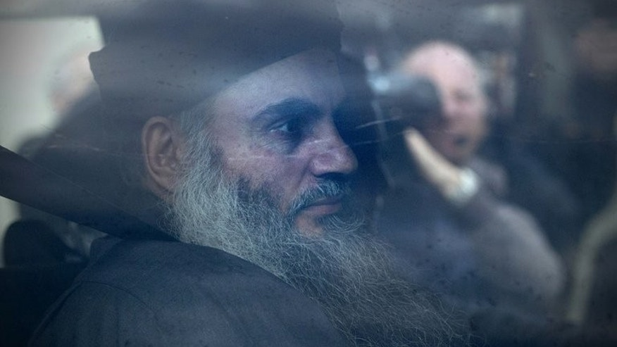 Terror suspect Abu Qatada arrives at his home in northwest London on November 13, 2012, after he was released from prison. The deportation from Britain to Jordan of radical Islamist cleric Abu Qatada poses a human rights test for Amman as it faces the challenge of ensuring he gets a fair trial, experts say.
