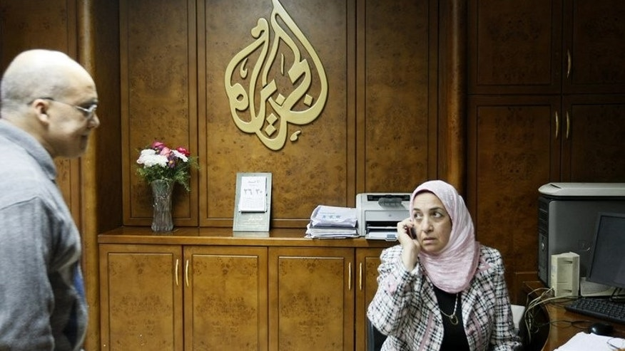 Al-Jazeera employees work at the pan-Arab television channel's bureau in Cairo on January 30, 2011. Several Al-Jazeera employees in Egypt have resigned because they disagreed with their employer's editorial line, an official at the Qatari television told AFP on Monday.