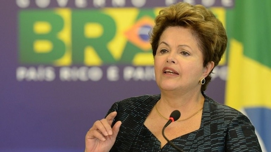 Brazilian President Dilma Rousseff delivers a speech at Planalto Palace in Brasilia, on July 3, 2013. Rousseff confirmed that the National Telecommunications Agency and federal police have been ordered to probe reports of US electronic spying on its citizens.