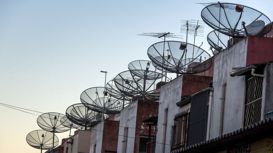 "Satellite dishes cover the roof tops of homes in Sao Paulo, Brazil, on July 13, 2012. A Brazilian newspaper has reported that Washington maintains a satellite intelligence collection base in Brazil jointly operated ""at least until 2002 by the NSA and the Central Intelligence Agency."""