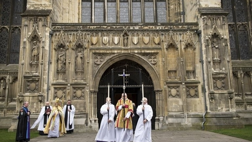The Archbishop of Canterbury, Justin Welby (3-L) leaves from the West Door at Canterbury Cathedral on March 21, 2013. The Church of England voted Monday to restart the process that would lead to ordaining women bishops after traditionalists blocked the idea last year, plunging the church into turmoil.
