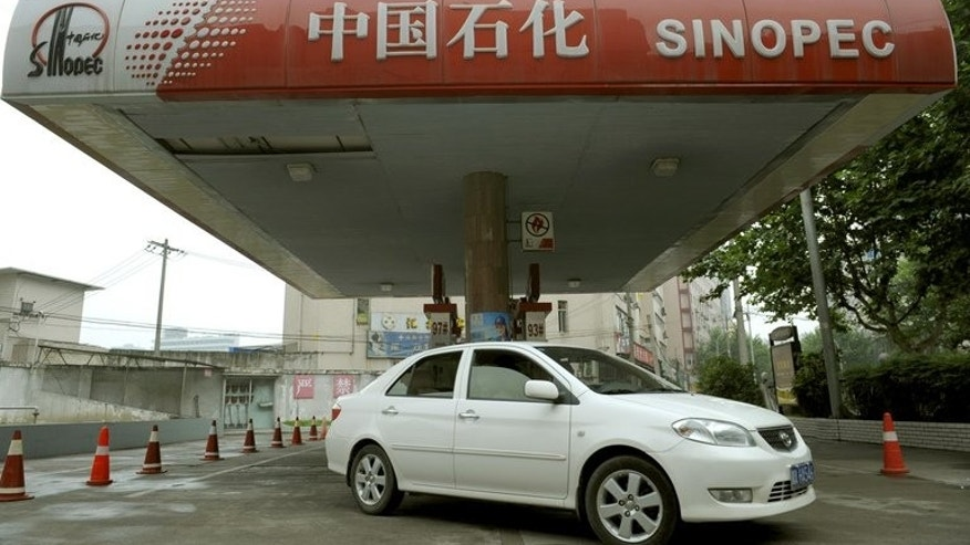 This file photo shows a car leaving a Sinopec service station in Chengdu, China's southwestern Sichuan province, on June 20, 2008. Gabon has taken the exceptional step of withdrawing the right of Addax Petroleum, a subsidiary of Sinopec, to exploit an oilfield, raising concerns over possible repercussions on the business climate.