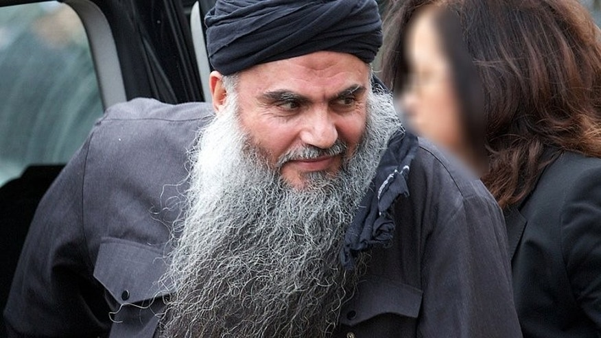Radical Jordanian cleric Abu Qatada arrives at his home in northwest London after he was released from prison on November 13, 2012. The lawyer of Islamist cleric Abu Qatada, who pleaded not guilty to terrorism charges in Jordan following his deportation from Britain, said he applied on Monday for his client's release on bail.