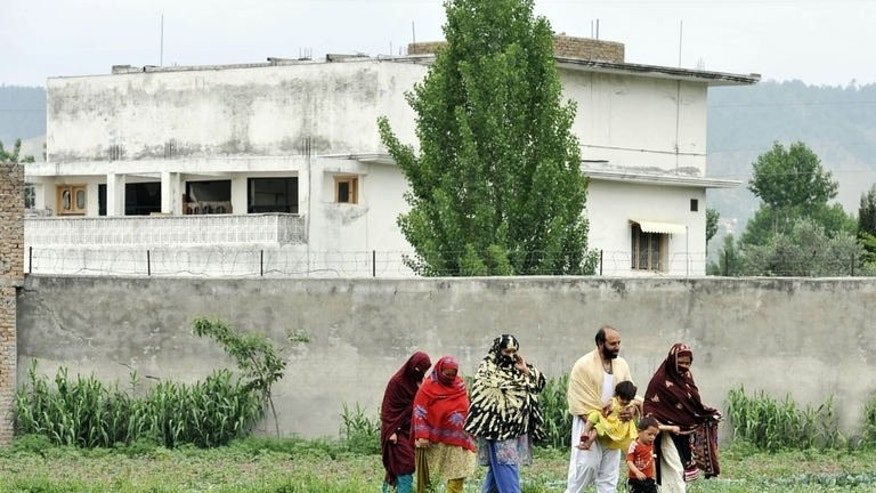 A Pakistani family leaves after visiting the hideout house of slain Al-Qaeda leader Osama bin Laden in Abbottabad on May 5, 2011. Pakistani collective failures, incompetency and negligence allowed Al-Qaeda leader Osama bin Laden to live in the country undetected for more than nine years, a leaked report has revealed Monday.
