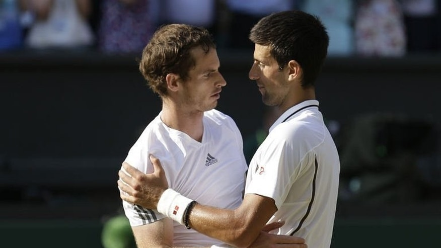 Britain's Andy Murray (L) embraces Serbia's Novak Djokovic after Murray's victory in the men's singles final on day thirteen of the 2013 Wimbledon Championships at the All England Club in Wimbledon, southwest London, on July 7, 2013. Djokovic and Murray have now contested three of the last four Grand Slam finals.