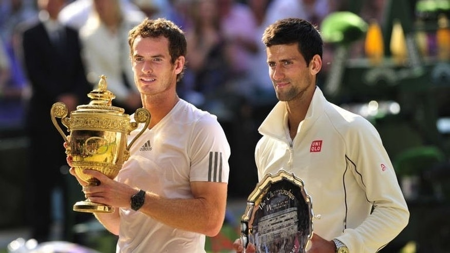 Britain's Andy Murray (L) poses with the winner's trophy next to runner up Serbia's Novak Djokovic during the presentation after the Wimbledon men's singles final at the All England Club in Wimbledon, southwest London, on July 7, 2013. Djokovic and Murray have now contested three of the last four Grand Slam finals.
