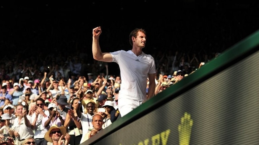 Andy Murray celebrates victory at Wimbledon on Sunday. Murray said Monday he is determined to push on from his stunning Wimbledon win and add further Grand Slam titles to his achievements.