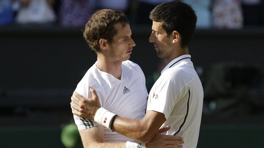 Andy Murray (left) embraces Novak Djokovic after Murray's victory at Wimbledon on Sunday. Murray's emotion-charged 6-4, 7-5, 6-4 win over top seed Djokovic on a baking-hot centre court on Sunday left the 26-year Scot drained but still lucid over what faces him next in his tennis career.