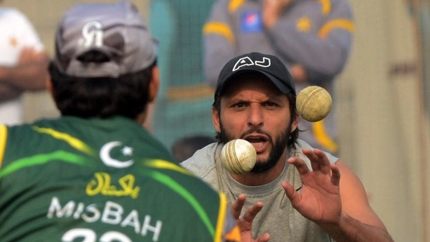 Shahid Afridi catches balls during a practice session at the Gaddafi stadium in Lahore, on December 15, 2012. A Pakistani film inspired by the fairytale career of Afridi goes on release next month, a heart-warming tale of raw talent that producers believe will be a smash hit.