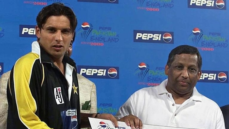 In this file photo, Pakistan's Shahid Afridi (L) receives the 'man of the match' award after an ODI match against England, in Lahore on October 27, 2000. A Pakistani film inspired by the fairytale career of cricket star Shahid Afridi goes on release next month, a heart-warming tale of raw talent that producers believe will be a smash hit.