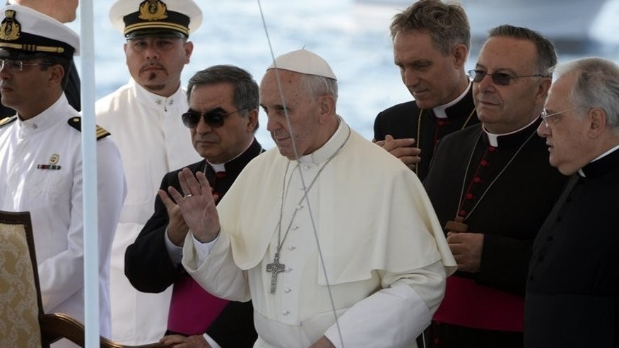 "Pope Francis boards a boat on July 8, 2013, on the Italian island of Lampedusa, to cast a wreath into the sea in memory of migrants who have drowned trying to reach Europe. He called for an end to ""indifference"" to the plight of refugees on the island where tens of thousands of migrants from Africa and the Middle East first reach Europe."