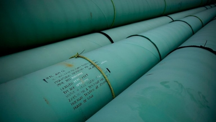This file photo shows pypes stacked at the southern site of the Keystone XL pipeline in Cushing, Oklahoma, on March 22, 2012. Construction of new pipelines has been unable to keep up with surging North American oil production, in part due to regulatory delays over concerns raised by environmental activists, and so a lot of crude is being shipped by rail.