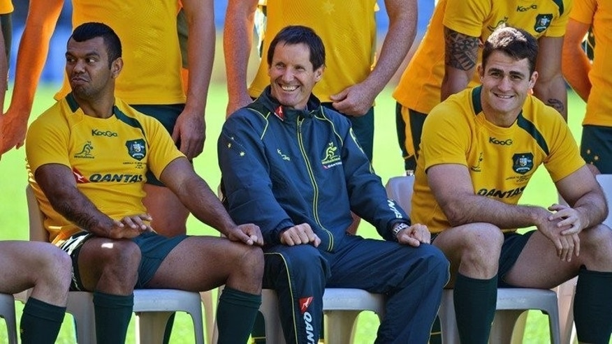 Robbie Deans (C) with Kurtley Beale (L) and Will Genia ahead of the third rugby Test match against the British and Irish Lions in Sydney on July 5, 2013. Deans quit Tuesday as coach of the Wallabies following their series loss to the Lions with Ewen McKenzie widely expected to be announced as his replacement.