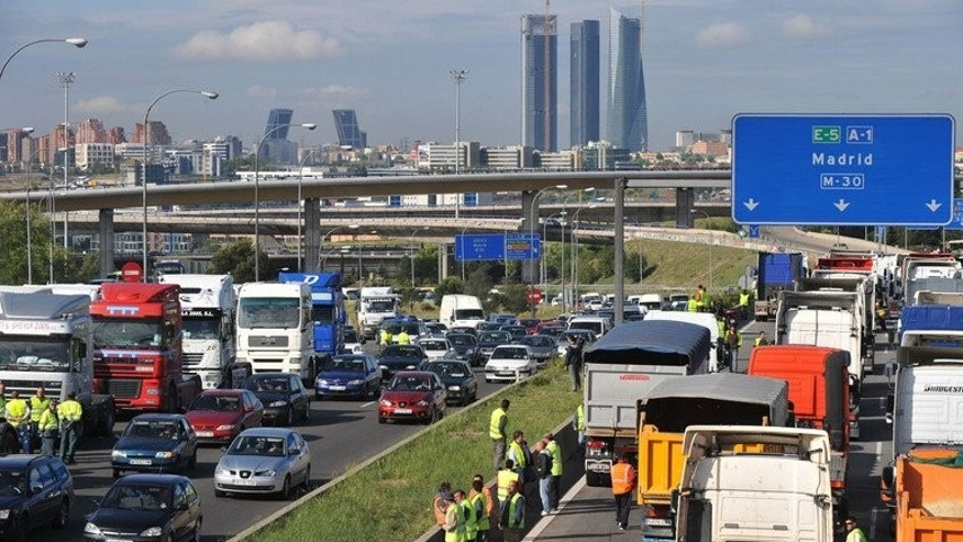 Traffic on the motorway into Madrid on June 10, 2008. A bus overturned and trapped people inside in a crash near the central Spanish city of Avila on Monday, killing at least nine passengers and seriously injuring another five, emergency services said.