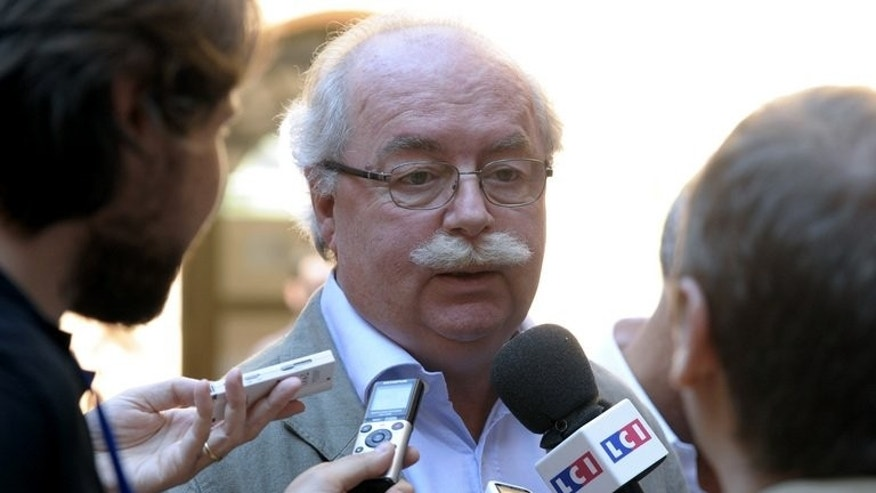 Christophe de Margerie speaks to journalists in Aix-en-Provence on Saturday. A French court on Monday acquitted energy giant Total, its chief executive, a former minister and more than a dozen other defendants of corruption charges in connection with Iraq's oil-for-food programme.