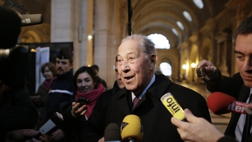 Charles Pasqua speaks to journalists in Paris in January. Total along with CEO Christophe de Margerie, former interior minister Charles Pasqua and more than a dozen former managers and retired diplomats, had always denied the graft allegations.
