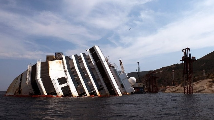 The Costa Concordia cruise ship lies in the water on July 7, 2013. The luxury liner crashed into a rock off Giglio on the night of January 13, 2012 with 4,229 people from 70 countries on board.