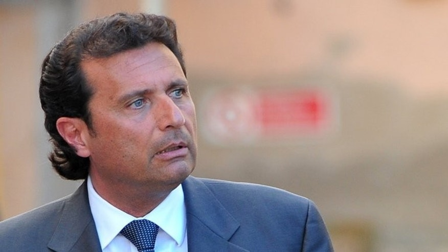 "Costa Concordia captain Francesco Schettino leaves court on April 15, 2013 in Grosseto. Dubbed Italy's ""most hated man"" by tabloids after he crashed a luxury cruise ship in 2012 with the loss of 32 lives, he goes on trial on Tuesday charged with their manslaughter."