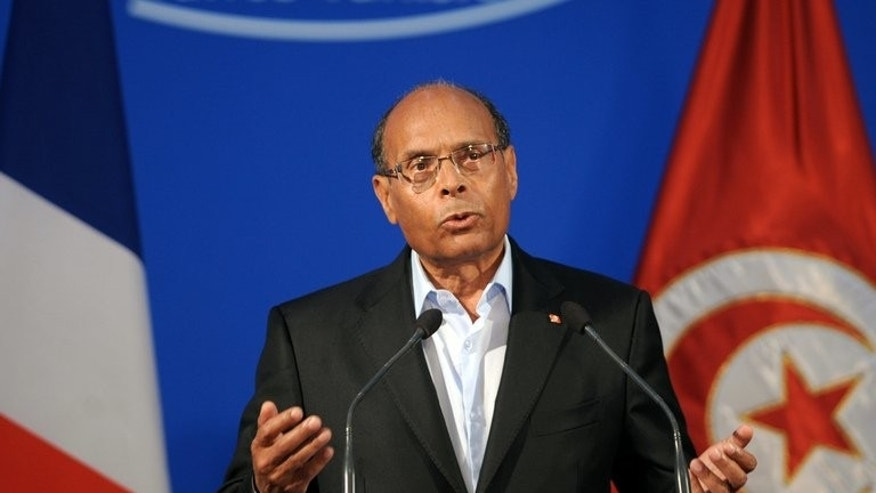 Tunisian President Moncef Marzouki gives a speech in Tunis, on July 5, 2013. The Tunisian presidency said on Monday it would extend by three months the state of emergency in place since the uprising that toppled former dictator Zine El Abidine Ben Ali in January 2011.
