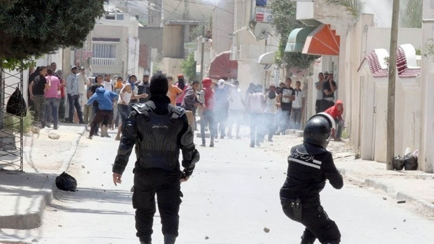 "Police clash with radical Islamists on May 19 in Ettadhamen, a poor neighbourhood west of Tunis. Tunisia's public prosecutor Monday ordered police to investigate an attack on 19 actors by Salafist Muslims, while they decided whether to charge the artists with alleged ""indecency"", a lawyer for the drama group said."