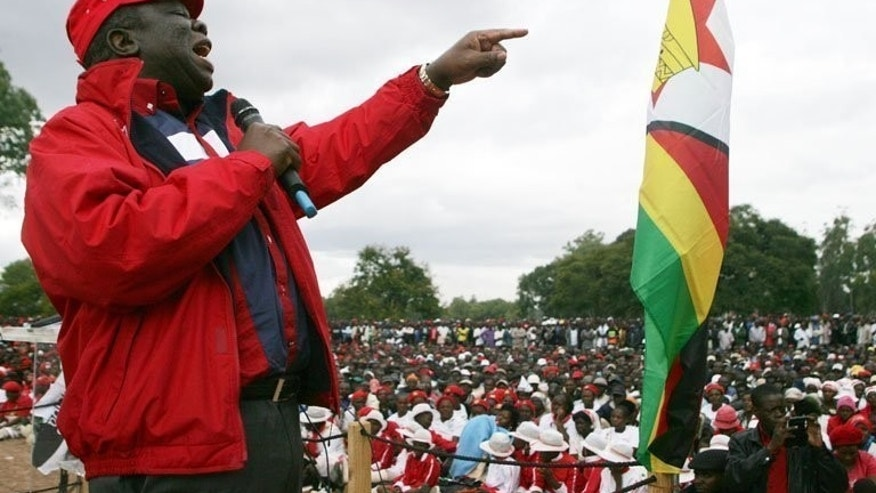 Morgan Tsvangirai speaks to party supporters at a party rally in Harare in May. Tsvangirai's Movement for Democratic Change (MDC) has joined forces with Mugabe's former finance minister Simba Makoni and the ZANU-Ndonga party ahead of elections on July 31.