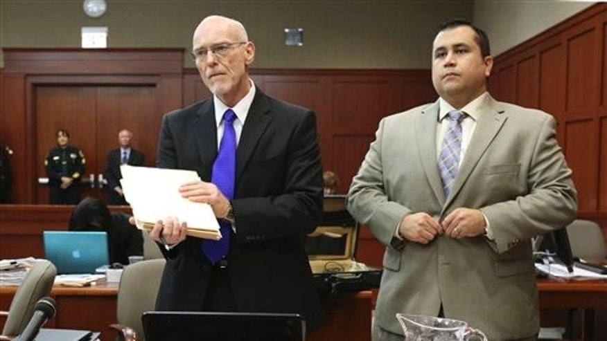 July 5, 2013: George Zimmerman stands next to one of his defense attorneys, Don West, during his trial in Seminole circuit court in Sanford, Fla. (AP/Pool Orlando Sentinel)