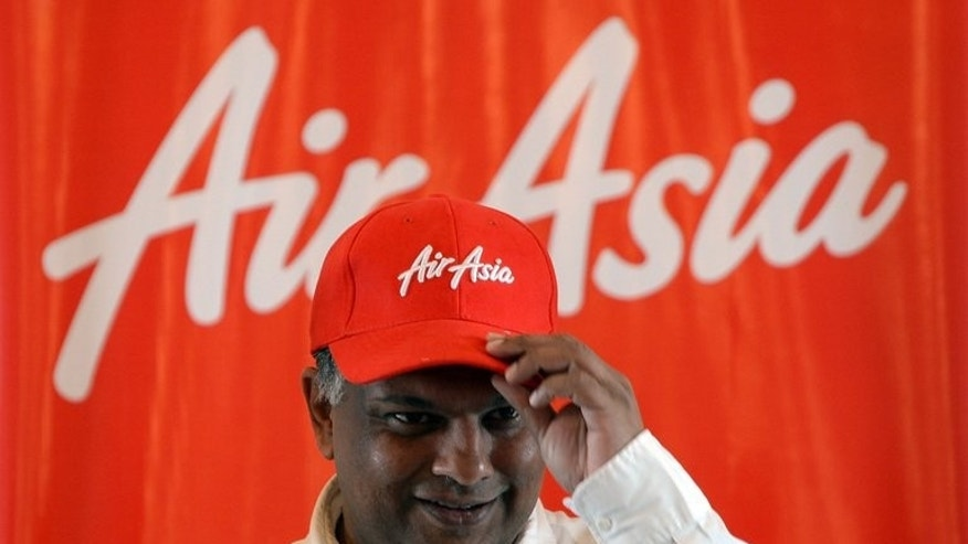 AirAsia chief executive Tony Fernandes at a press conference in Mumbai on July 1, 2013. The Asian budget airline king may face his toughest fight yet in India's hyper-competitive aviation market where existing players are struggling to make a profit, analysts say.