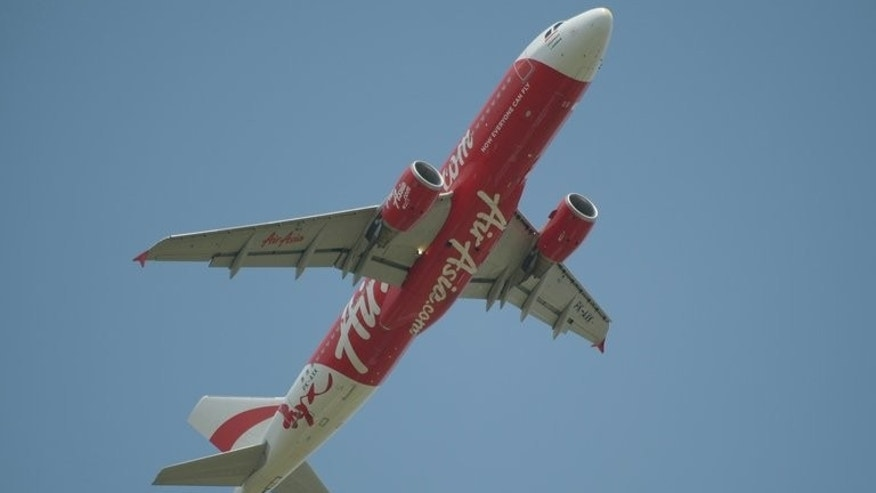 This picture taken in Tangerang on March 18, 2013 shows an Indonesia Air Asia plane. Analysts warn Tony Fernandes could be in for a turbulent ride in India's skies where low-cost carriers already dominate with a near 65-percent market share.
