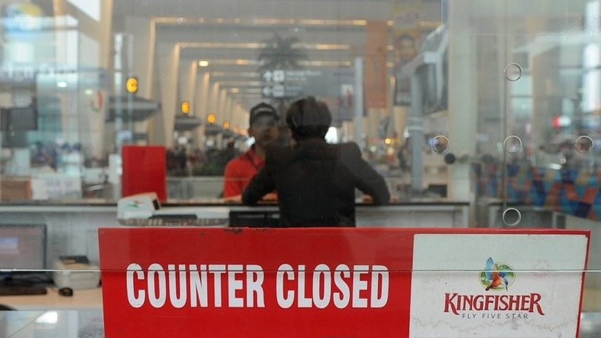 The closed window of a Kingfisher Airlines booking counter in New Delhi on October 20,2012. Kingfisher has been grounded by the regulator and is on the verge of bankruptcy.