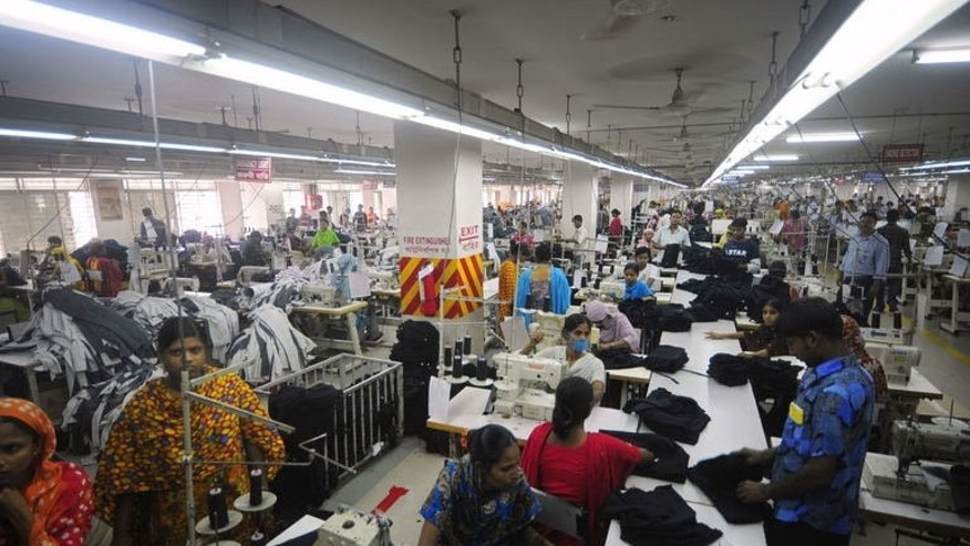 In this photograph taken on June 23, 2010, Bangladeshi women sew clothes in a garment factory in Ashulia. Output from Bangladesh's accident-prone garment sector has increased in June, with demand from foreign retailers still growing despite the country's factory disaster in April.