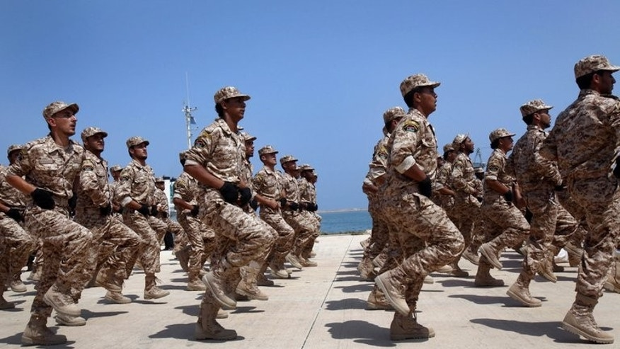 "Libyan soldiers march during their graduation ceremony in Tripoli, on July 3, 2012. Britain is to train up to 2,000 Libyan troops in a bid to ""help them achieve peace and stability across their country"", the British defence ministry announced"