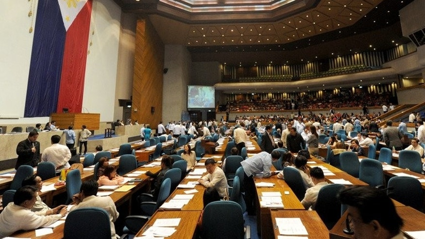 In this file photo, members of the Philippine house of representatives meet to vote ahead of schedule to terminate heated debates on a controversial birth control law after President Benigno Aquino urged its speedy passage, in Quezon City, suburban Manila, on August 6, 2012.