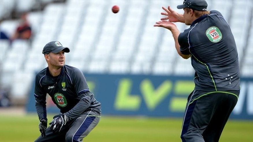Australia's Michael Clarke (L) and Shane Watson during a practice session at Trent Bridge in Nottingham on July 8, 2013. Australia come into this series with huge question marks over their batting which, with the exception of Clarke, lacks proven world-class performers.