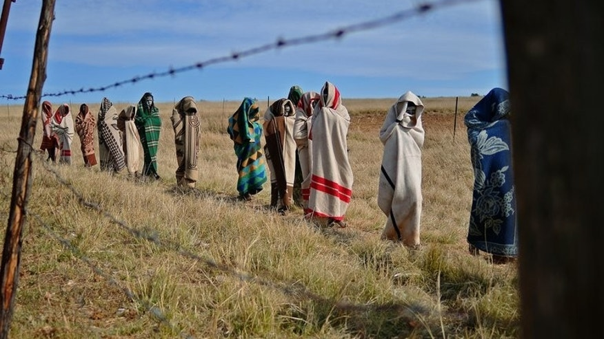 Boys from the Xhosa tribe who have undergone a circumcision ceremony walk near Qunu on June 30, 2013. Five people have appeared in court in a South African province where bungled traditional initiation rites killed 30 young men and landed almost 300 more in hospital, police said Tuesday.