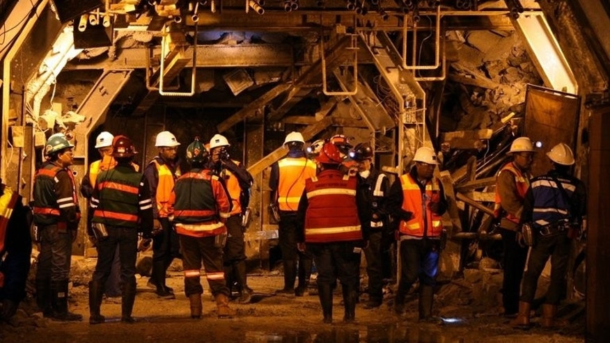 In this photograph taken on May 24, 2013 rescue and safety officials from the Freeport-McMoRan mining company inspect the site of a tunnel collapse in Grasberg. The US mining giant has said it will resume underground operations at its site in eastern Indonesia, nearly two months after a tunnel collapse killed 28 workers.