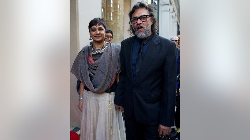"Filmmaker Rakeysh Omprakash Mehra (R) arrives for the premiere of ""Bhaag Milkha Bhaag"" in London on July 5, 2013. The courageous story of Milkha Singh -- India's most successful ever track athlete, who overcame childhood tragedy to seek Olympic glory -- is the latest Bollywood biopic to hit cinemas."
