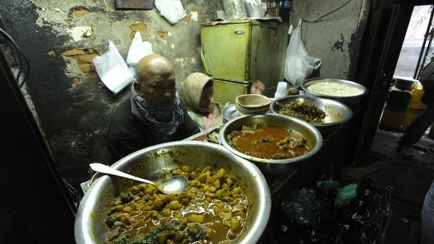 A Newari bhatti vendor waits for customers at his shop in Kathmandu on January 9, 2012. A typical bhatti might serve 60 people on a good day, making around 4,000 rupees after expenses are deducted, although staff costs are low, with the owner usually doubling as waiter, barman and chef.