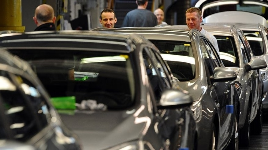 Employees work on the production line at the Vauxhall car factory in Ellesmere Port, northwest England, on May 17, 2012. British manufacturing output sank unexpectedly in May, official data showed on Tuesday, sparking fresh concern about the strength of the economic recovery.