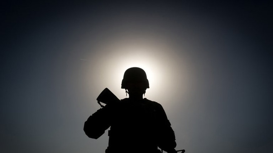 "An Afghan soldier on patrol near Kandahar, on November 28, 2010. An Afghan soldier has shot dead his Slovakian counterpart in the latest ""insider attack"" to shake efforts by the NATO coalition and the Afghan army to work together to defeat the Taliban insurgency."