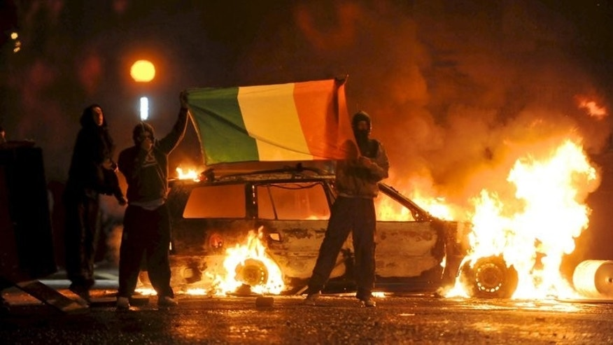 Cars burn during Nationalist rioting in the Ardoyne area of Belfast on July 12, 2010. Protestant marchers in Northern Ireland will not be allowed to pass through the Catholic Ardoyne district following serious rioting in recent years, The Parades Commission ruled.
