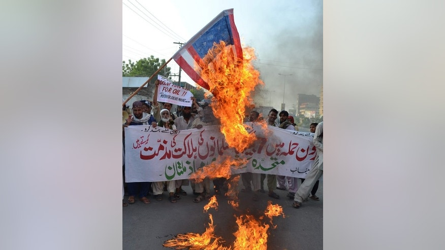 Pakistani protesters torch a US flag during a rally in Multan, on June 8, 2013. US drone attacks in tribal areas are deeply unpopular in Pakistan. Pakistan reached an understanding with the United States on drone strikes targeting Islamist militants and the attacks can be useful, according leaked remarks from a former intelligence chief.