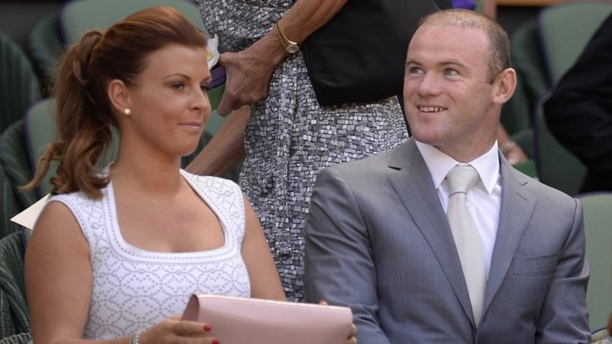 Manchester United's Wayne Rooney and his wife Coleen in the royal box at Wimbledon on July 7, 2013. Intense speculation over Rooney's future looks set to dominate the headlines this week as United begin their new era under David Moyes at the start of a bumper series of pre-season tours to Asia.
